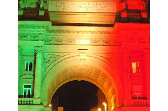 the arc by night illuminated by the colors of the Italian flag