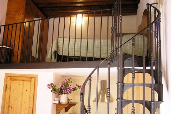 staircase leading up to a spacious mezzanine